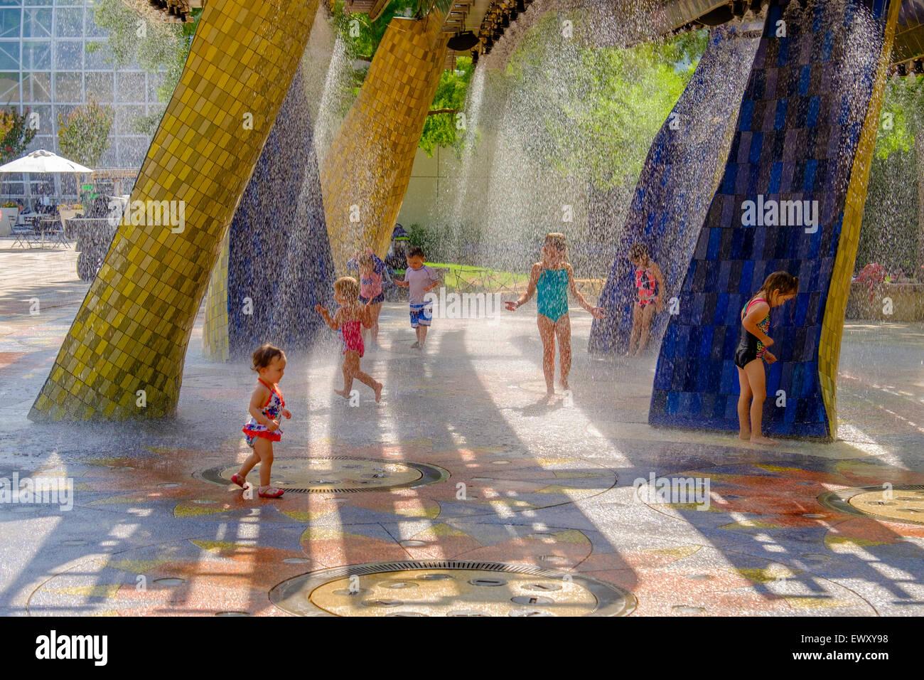 Children Play At A Splash Park At The Myriad Botanical Gardens In Oklahoma  City, Oklahoma, USA