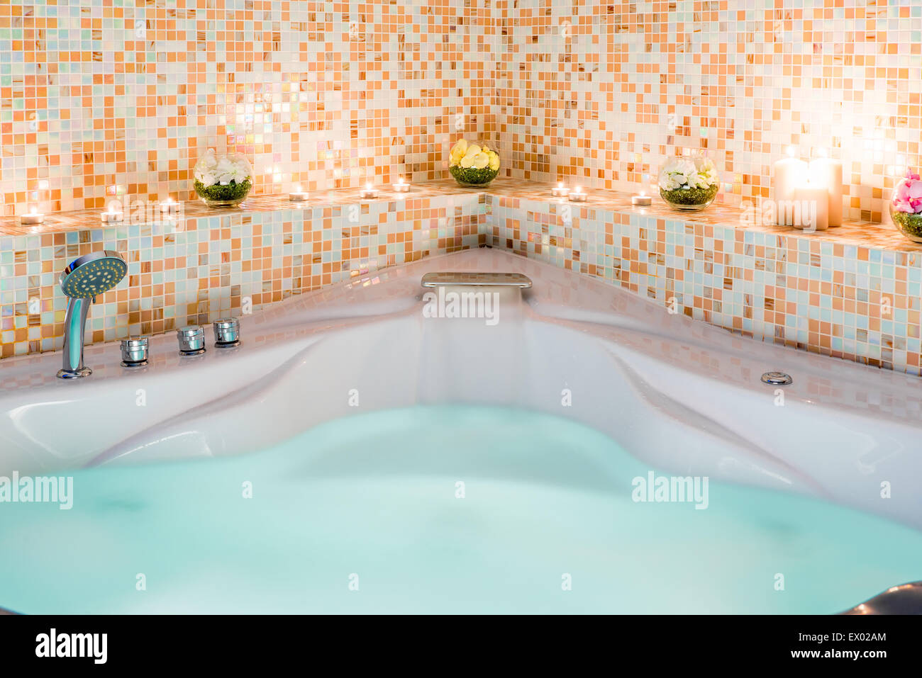 large Jacuzzi with water and burning candles Stock Photo, Royalty ...