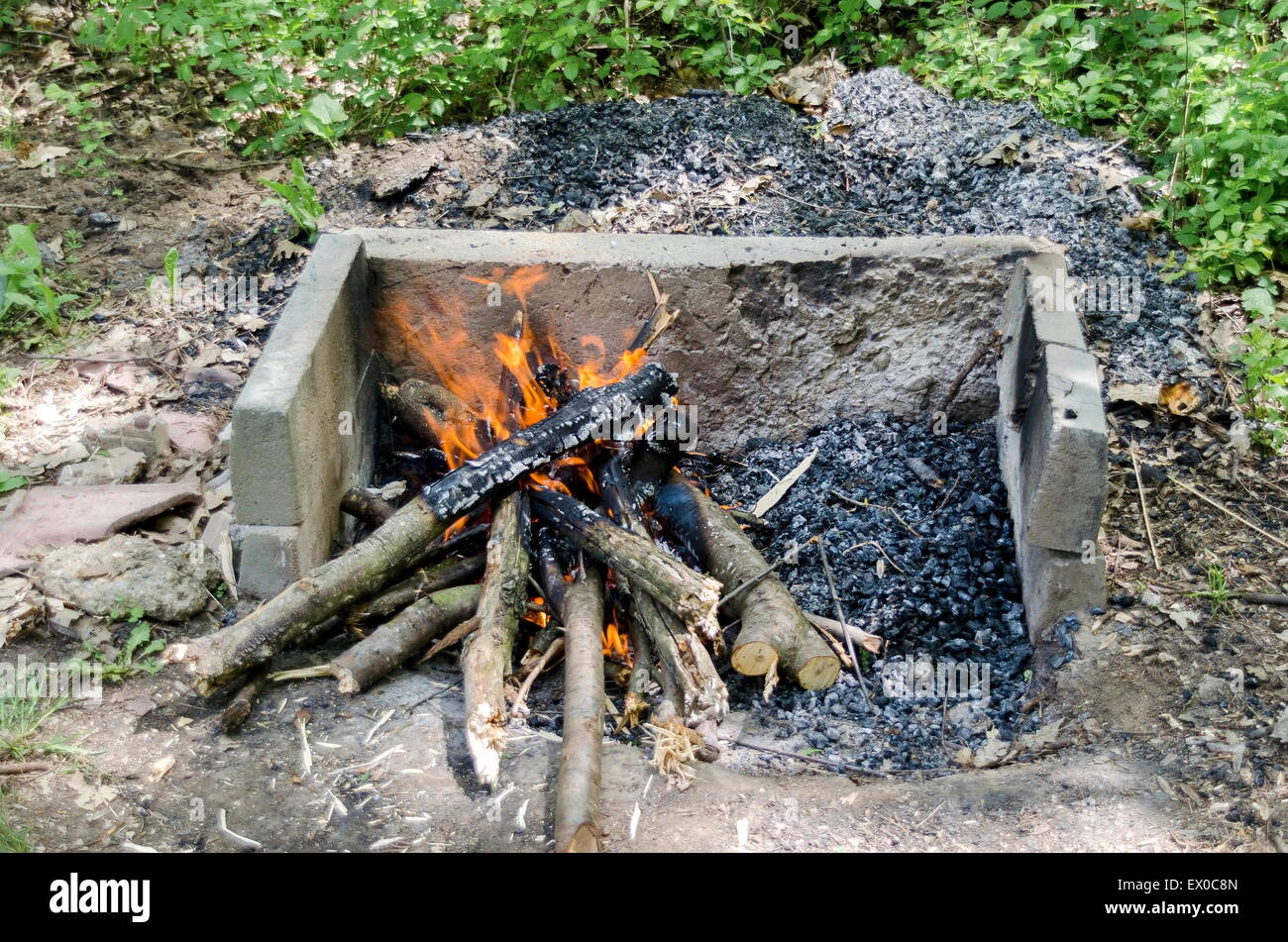 open fire in the fireplace prepare coal for barbeque grill stock