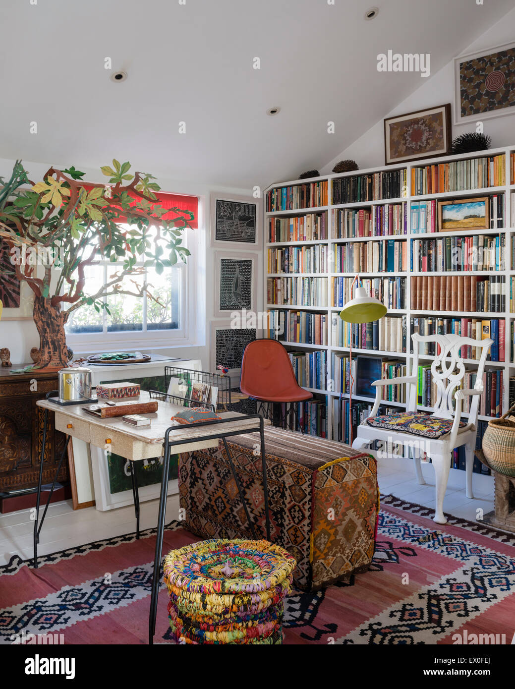 Inbuilt Book Shelving In Living Room With Uzbek Rug Kilim Covered Bench And Aboriginal Wall Art