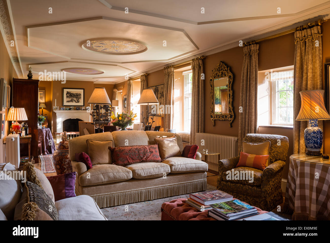 long drawing room with sofas fireplace and ceiling paintings