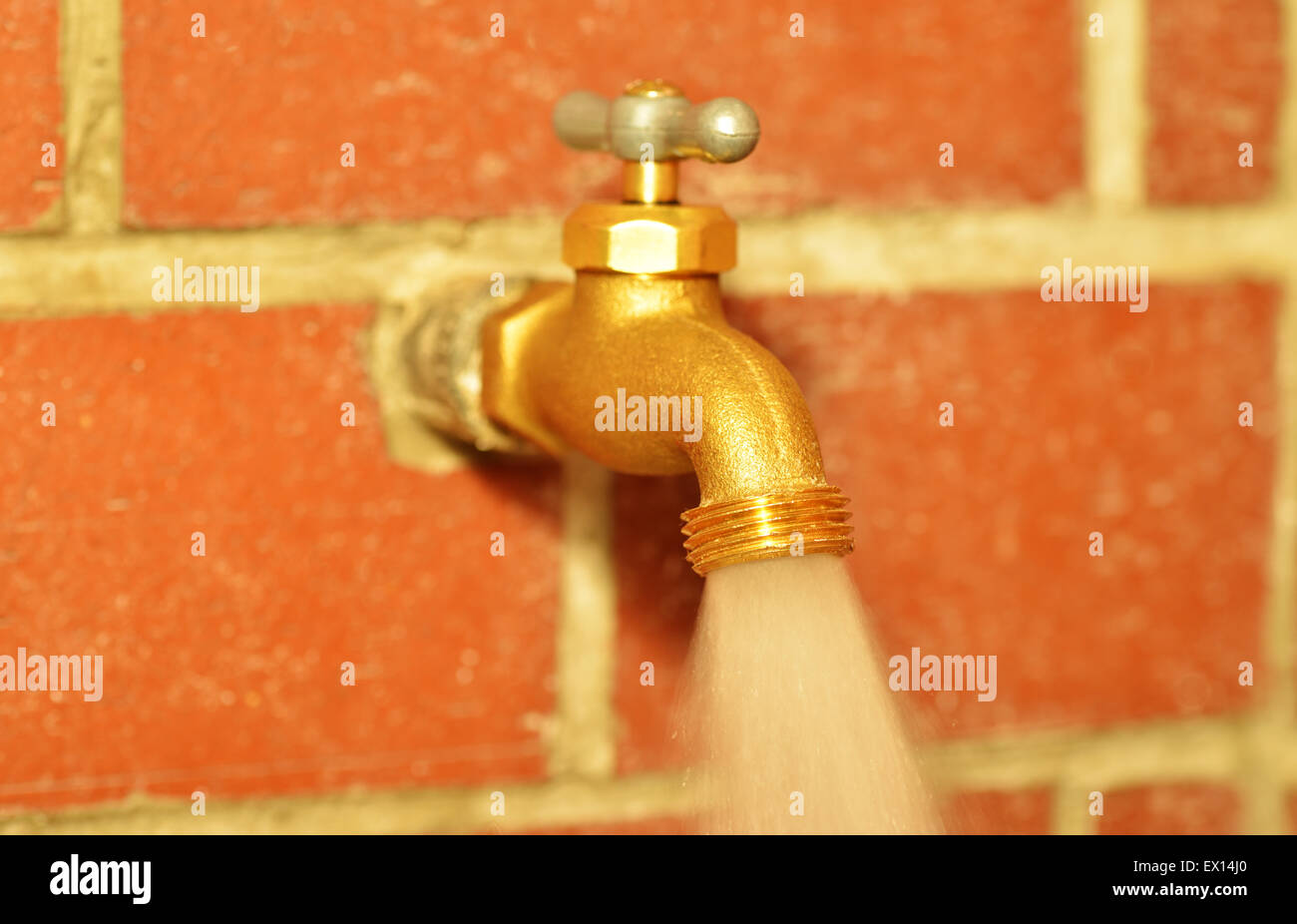 Close up of a traditional water faucet open with water running Stock ...