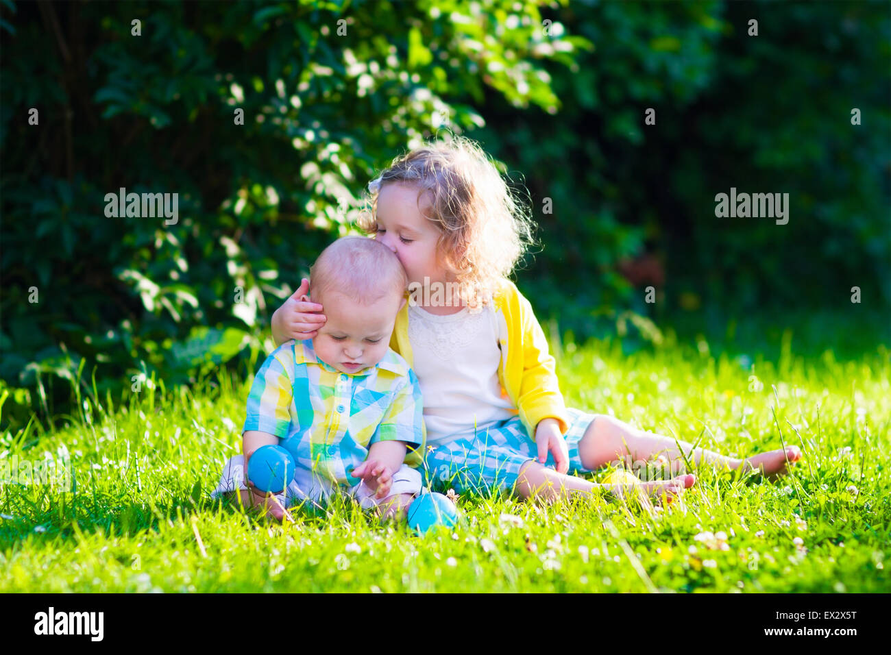 children playing in the garden  toddler kid and little baby play stock photo  royalty free image