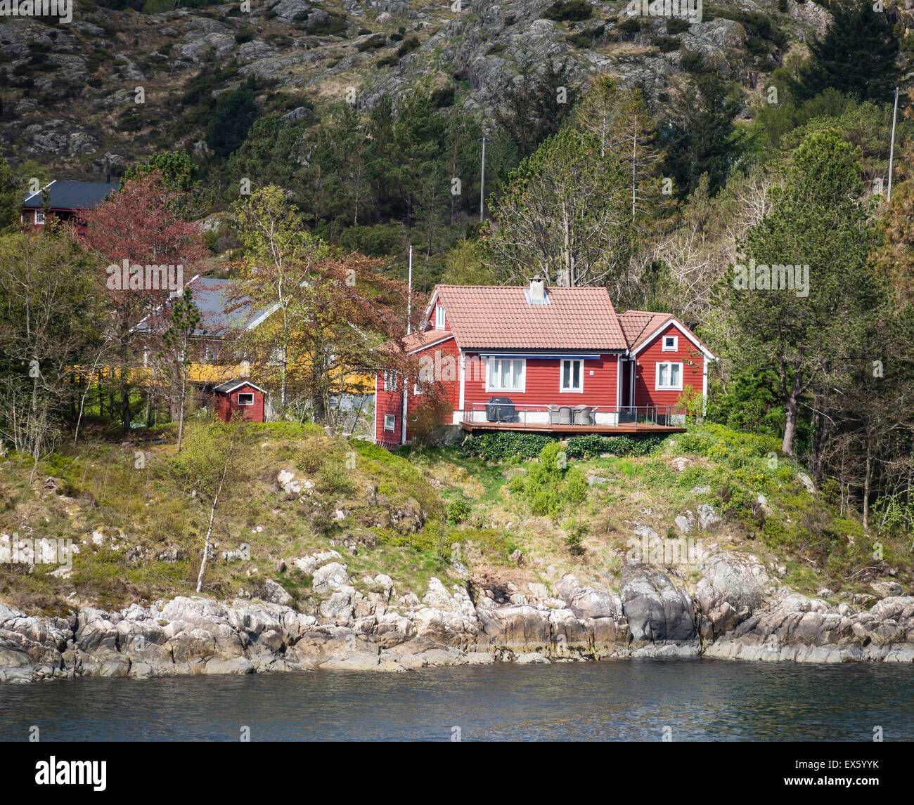 Stock Photo   Typical Norwegian Summer Hut, Near Sea Level, Hardangerfjord,  Seen From Ferry Approaching Bergen Harbor, Norway