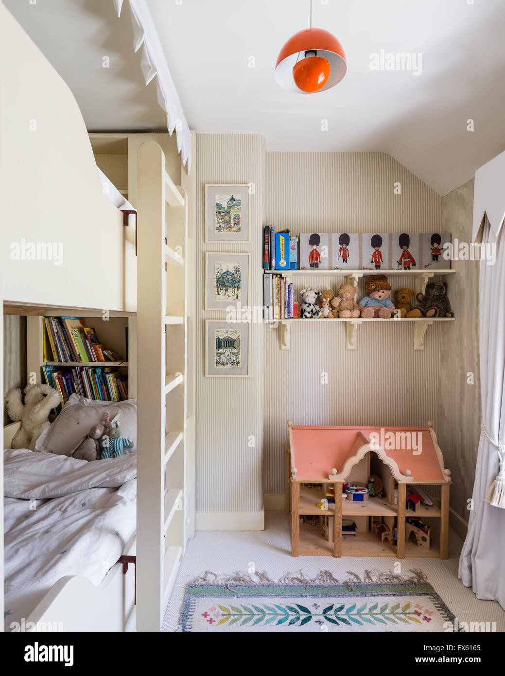 Osborn and Little striped wallpaper in kids bedroom with bunk beds and  Polish folk rug. Osborn and Little striped wallpaper in kids bedroom with bunk beds