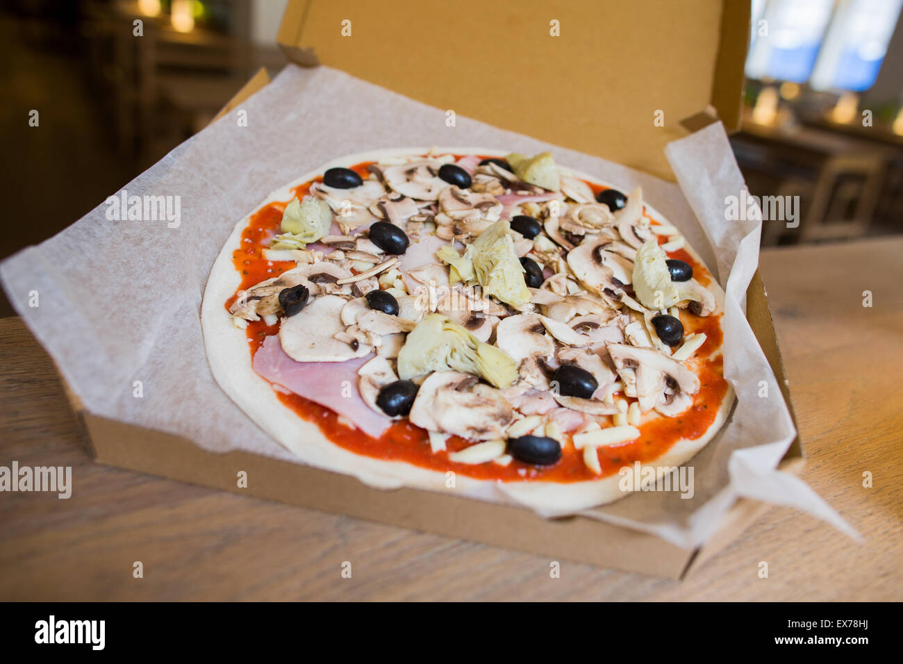 Bonn germany 7th july 2015 a raw pizza lay on the table at the bonn germany 7th july 2015 a raw pizza lay on the table at the vapiano headquaters in bonn germany 7 july 2015 the restaurant chain hopes in the sciox Images