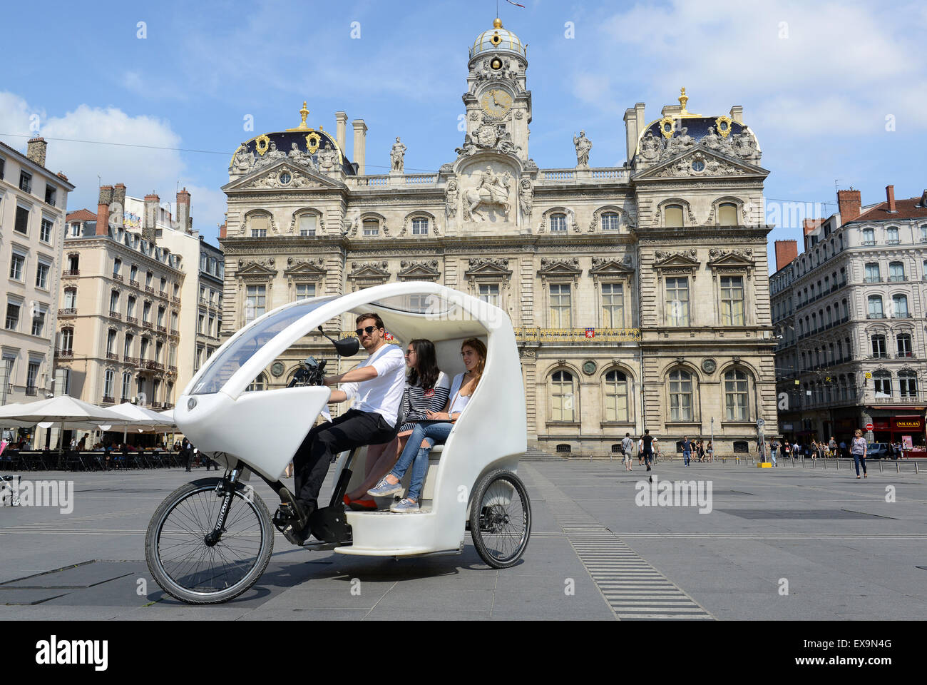 three wheel electric tourist pedal car taxi in lyon france french stock photo royalty free. Black Bedroom Furniture Sets. Home Design Ideas