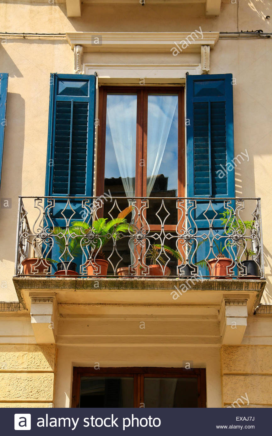 Wrought Iron Balcony Withfrench Doors, ,wooden Shutters