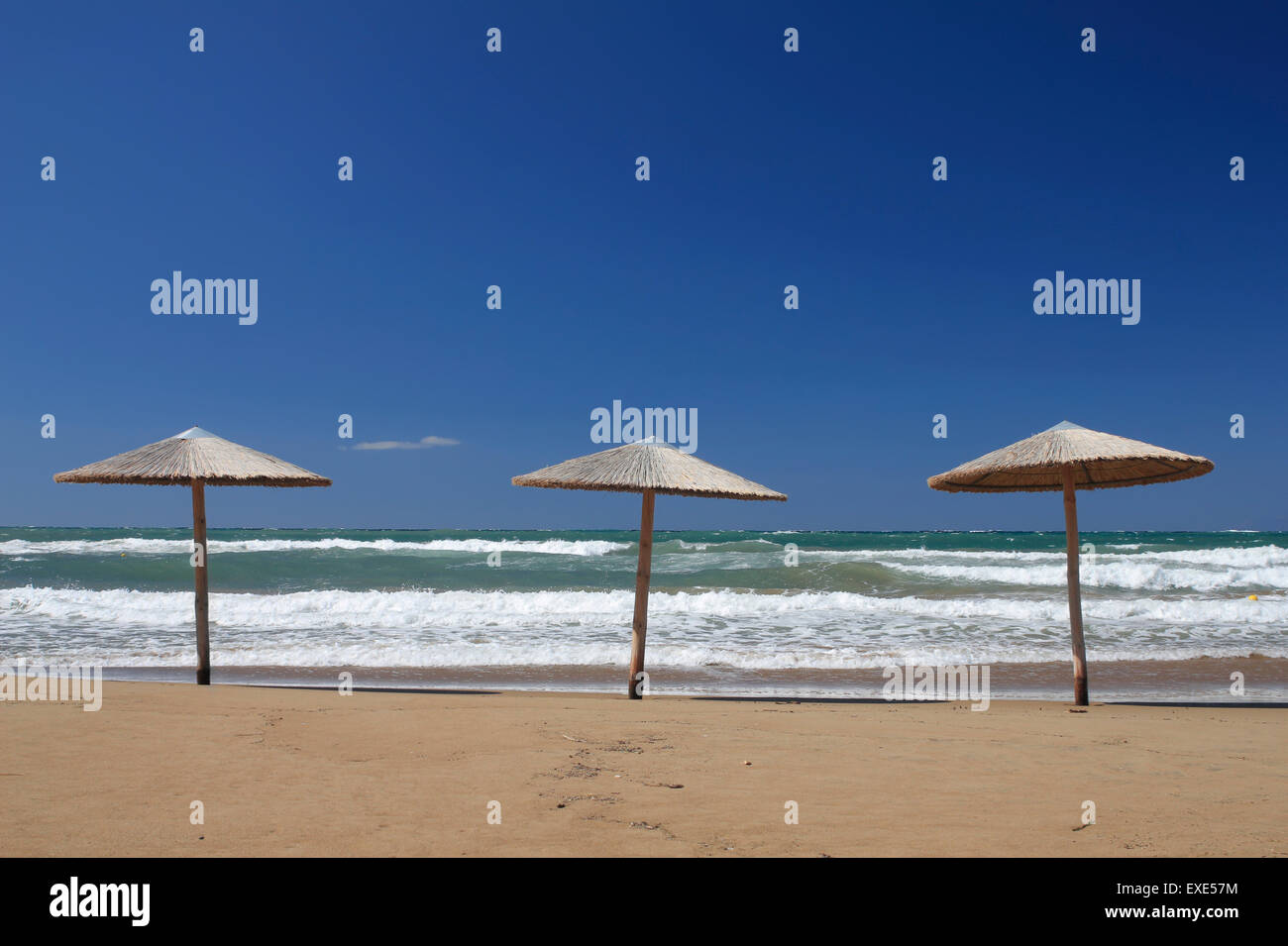 Three Umbrella Kiosks And White Billows Surge Of The Sea At Reha Rixa Recha Nera Beach Androni Suburb Myrina Limnos