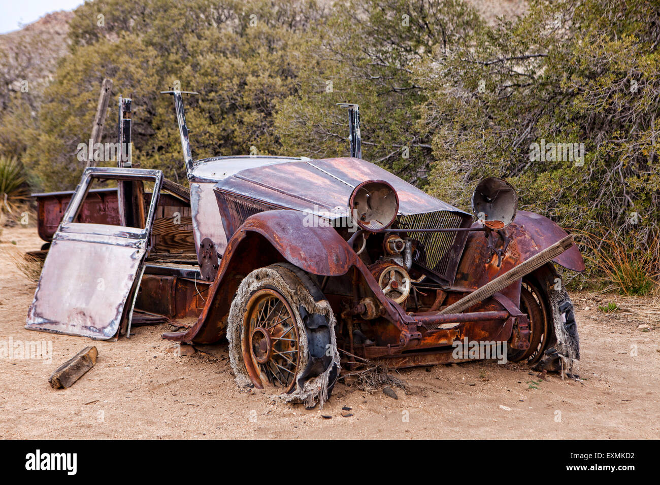 an abandoned car left over from the wall street mill and mine in joshua tree national park california usa