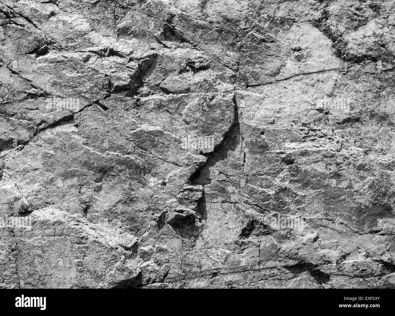 Rough Granite Stone : Rough dark gray rock wall natural stone surface