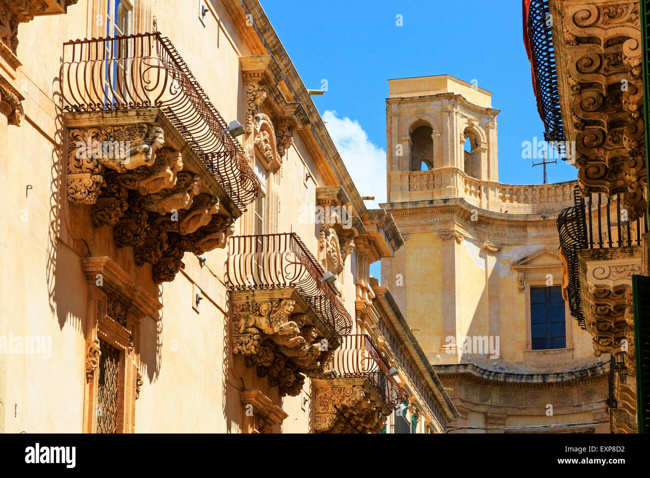 baroque architecture and balcony buttresses on buildings in via