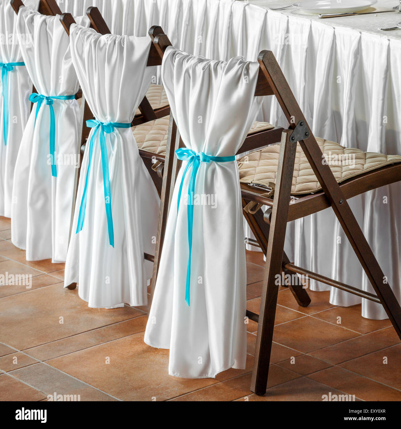 Row Of Wedding Chairs, Decorated With White Fabric And Blue Ribbons