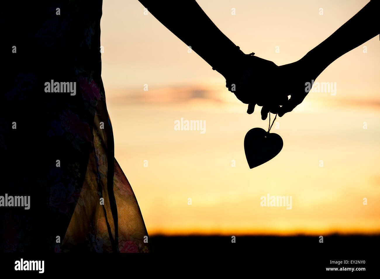 Boy And Girl Holding Hands Silhouette Stock Photos & Boy And Girl ...
