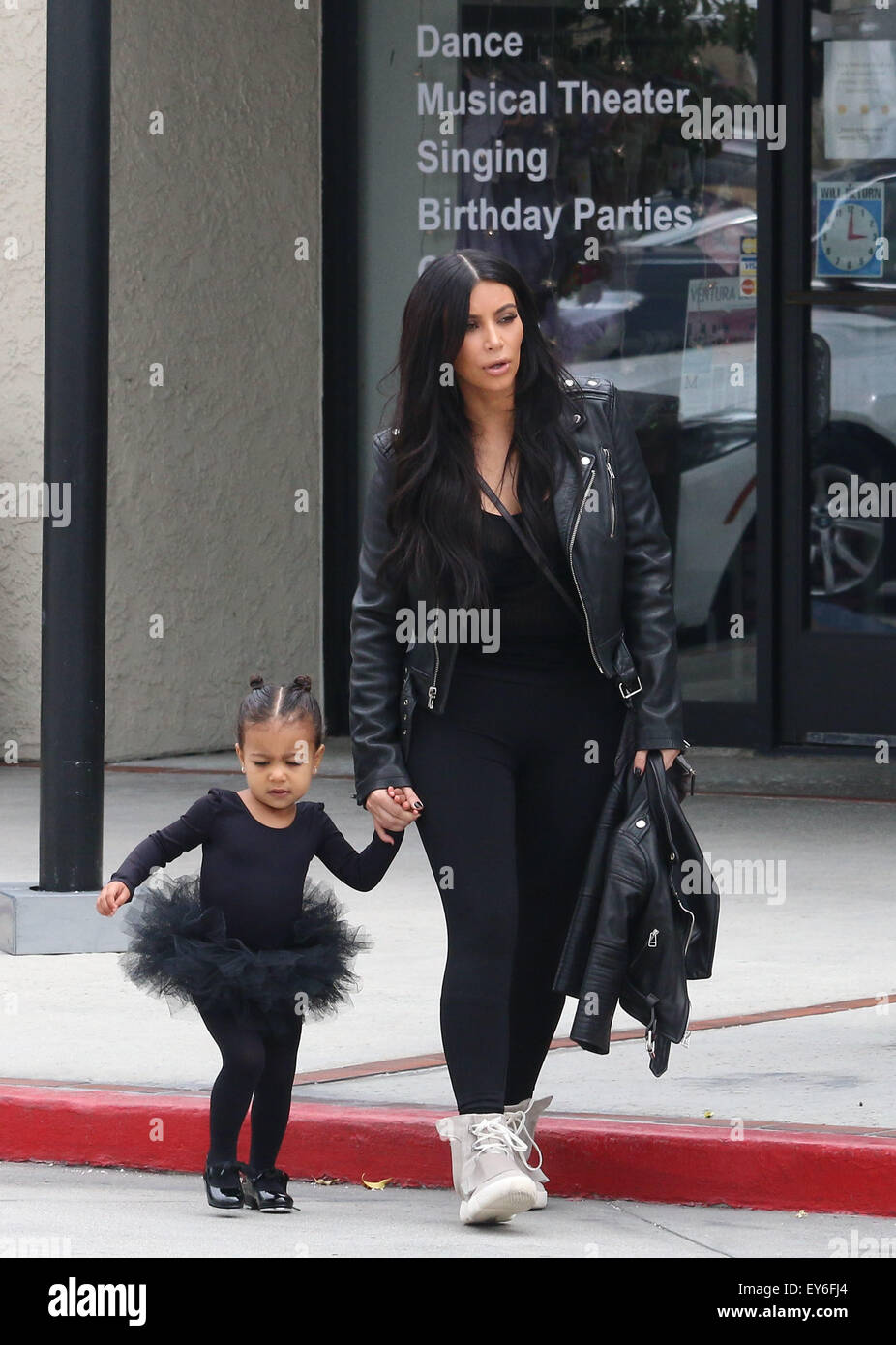 Kim Kardashian, sporting her husband\u0027s adidas Yeezy Boost by Kanye West  sneaker, takes daughter
