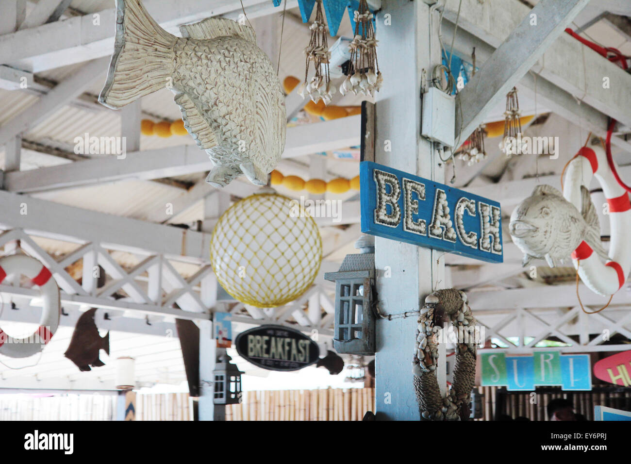 Beach themed signage and decor decorate this seaside
