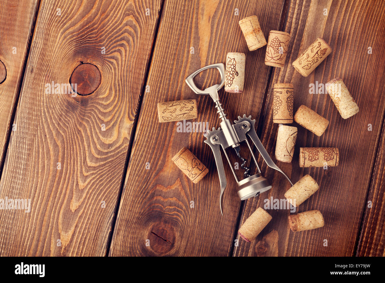 Stock Photo   Wine Corks And Corkscrew Over Rustic Wooden Table Background.  Top View With Copy Space
