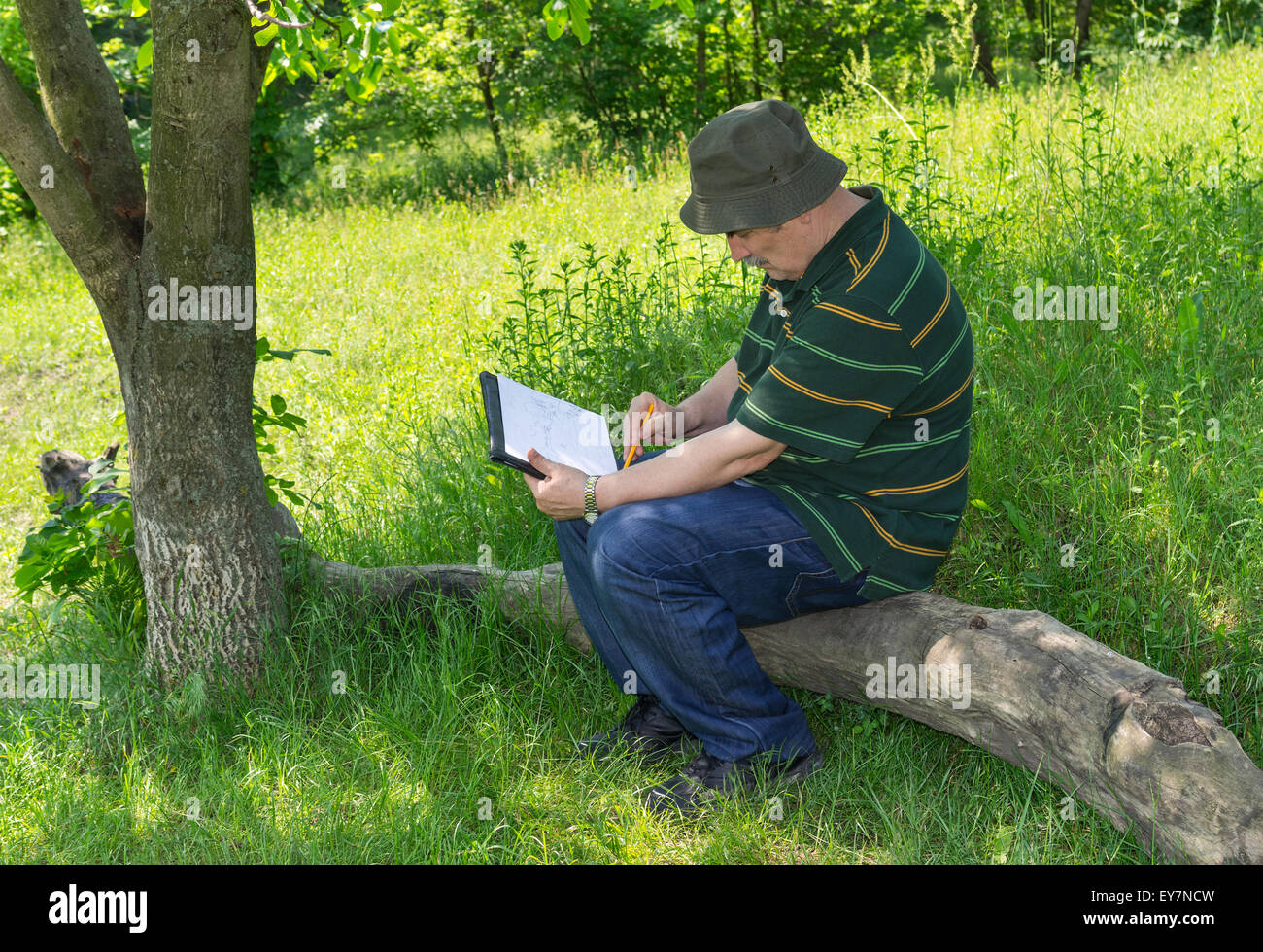 mature painter doing sketch outdoor stock photo, royalty free image