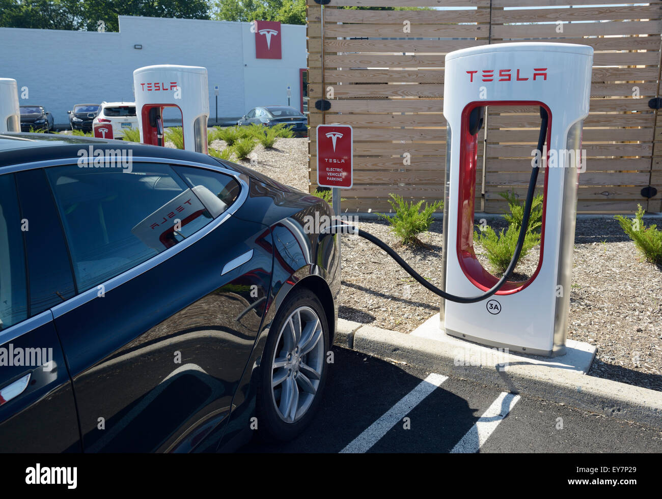 Electric Car Charging Station With A Tesla Sedan Plugged In Tesla