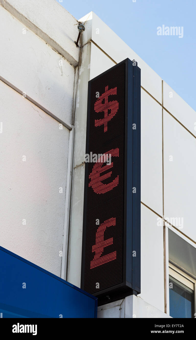 Dollar euro and british pound symbols above a currency exchange dollar euro and british pound symbols above a currency exchange shop in bodrum turkey biocorpaavc Images