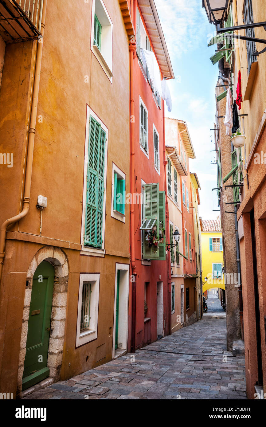 Colourful buildings with bright window shutters along for Cobblestone shutters