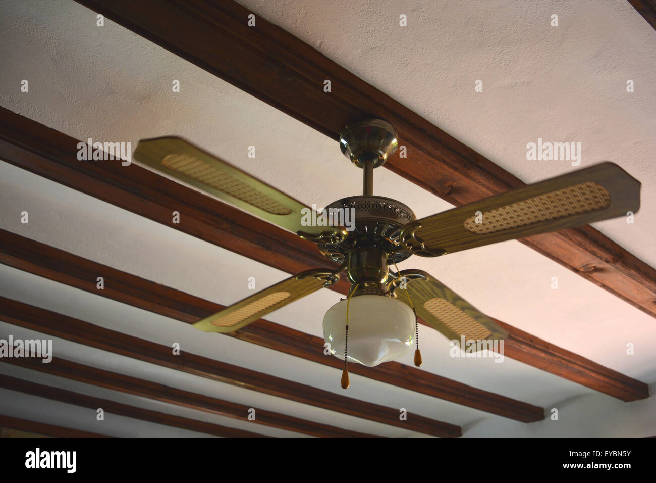 ceiling fan with a light fitting, spain stock photo, royalty free