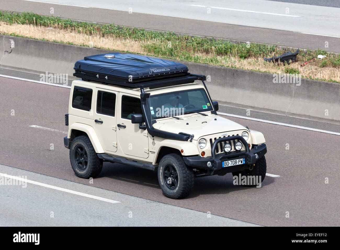 Jeep Wrangler unlimited with a roof tent box moving fast on the highway A5. July 26 2015 in Frankfurt Main Germany : jeep wrangler tent - memphite.com