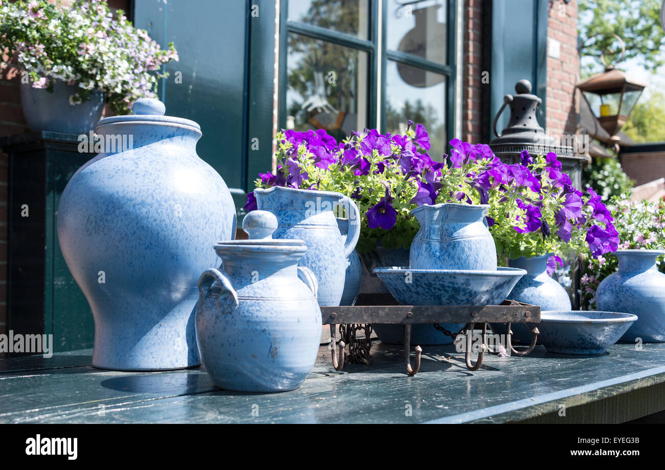Table in front of house window with bleu clay vases and other table in front of house window with bleu clay vases and other pottery next to pertunia flower reviewsmspy