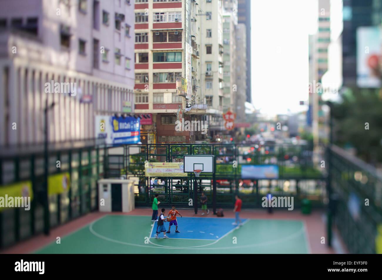 an outdoor basketball court in an urban area hong kong