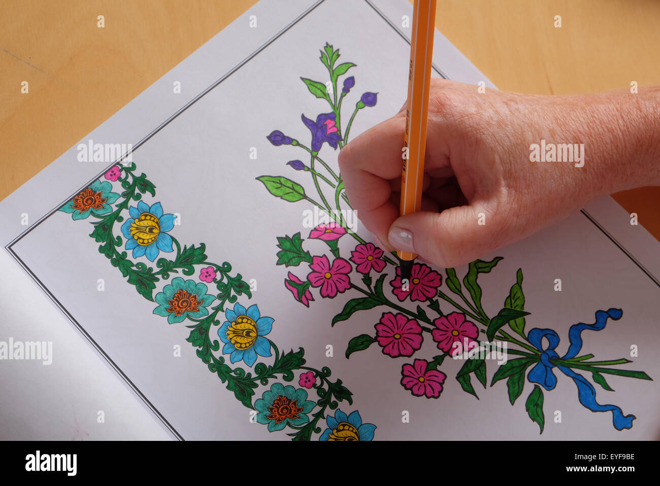 Colouring in book free - An Adult Woman Colouring In A Vintage Design Colouring In Book A New Trend In Relaxation For Adults