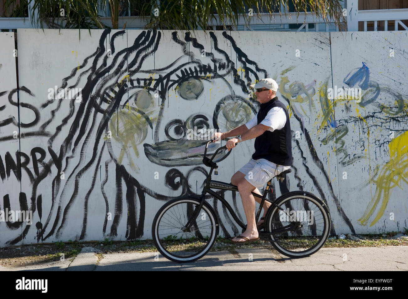 Graffiti wall usa - Stock Photo Usa Florida Keys Male Cyclist Passes Graffiti Wall Key West