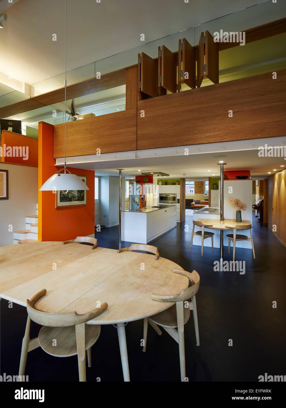 Mezzanine Area dining area with view through towards mezzanine, kitchen and