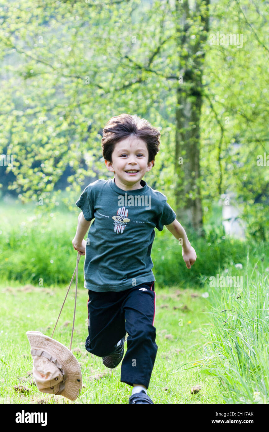 5 to 7 year old Caucasian boy. Outdoor, running towards viewer in Stock Photo, Royalty Free ...