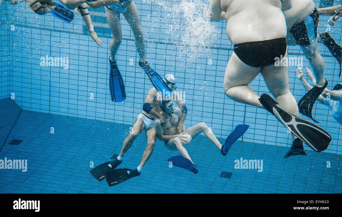 swimmers play underwater rugby in the public swimming pool at the olympic stadium in berlin germany 29 july 2015 the players try to score by placing the