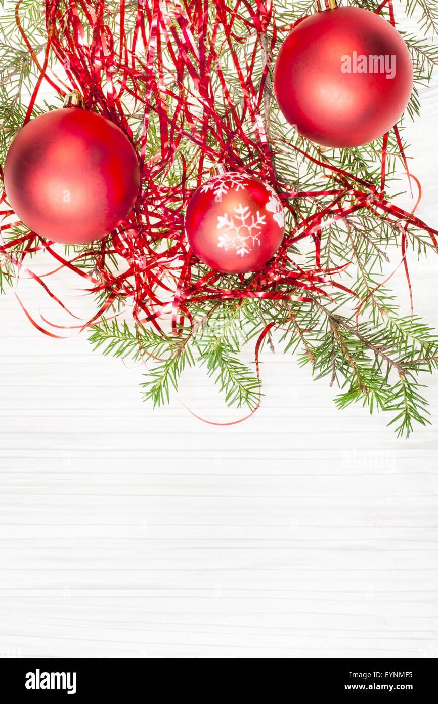 Christmas greeting card border from three red xmas baubles and christmas greeting card border from three red xmas baubles and tree branch on blank paper background kristyandbryce Choice Image