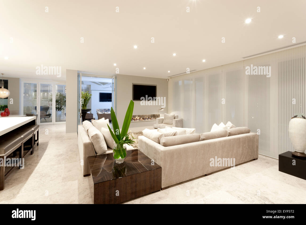 Spacious living room with gray sofas and beautiful lighting Stock ...