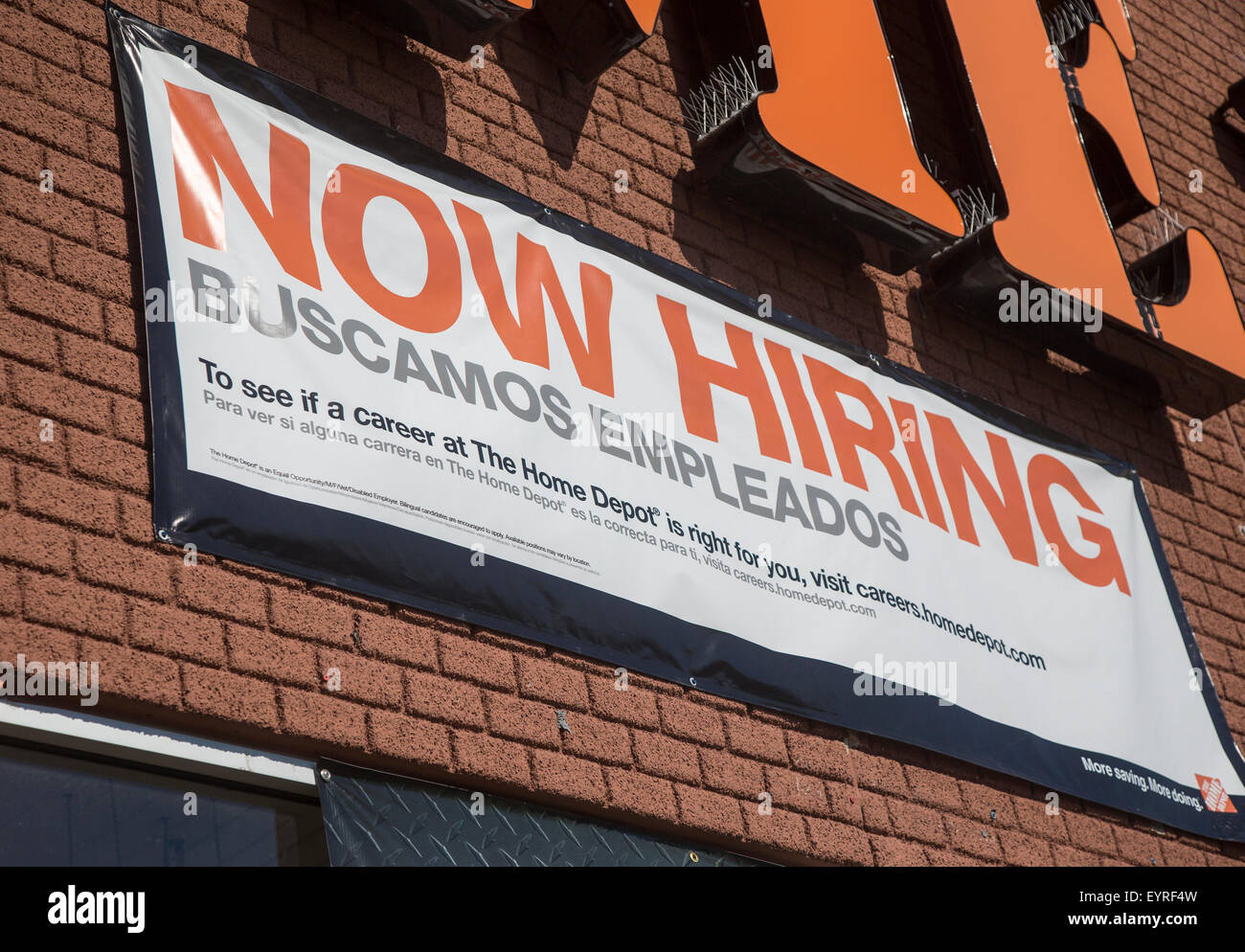 Now Hiring sign at a Home Depot Stock Photo Royalty Free Image