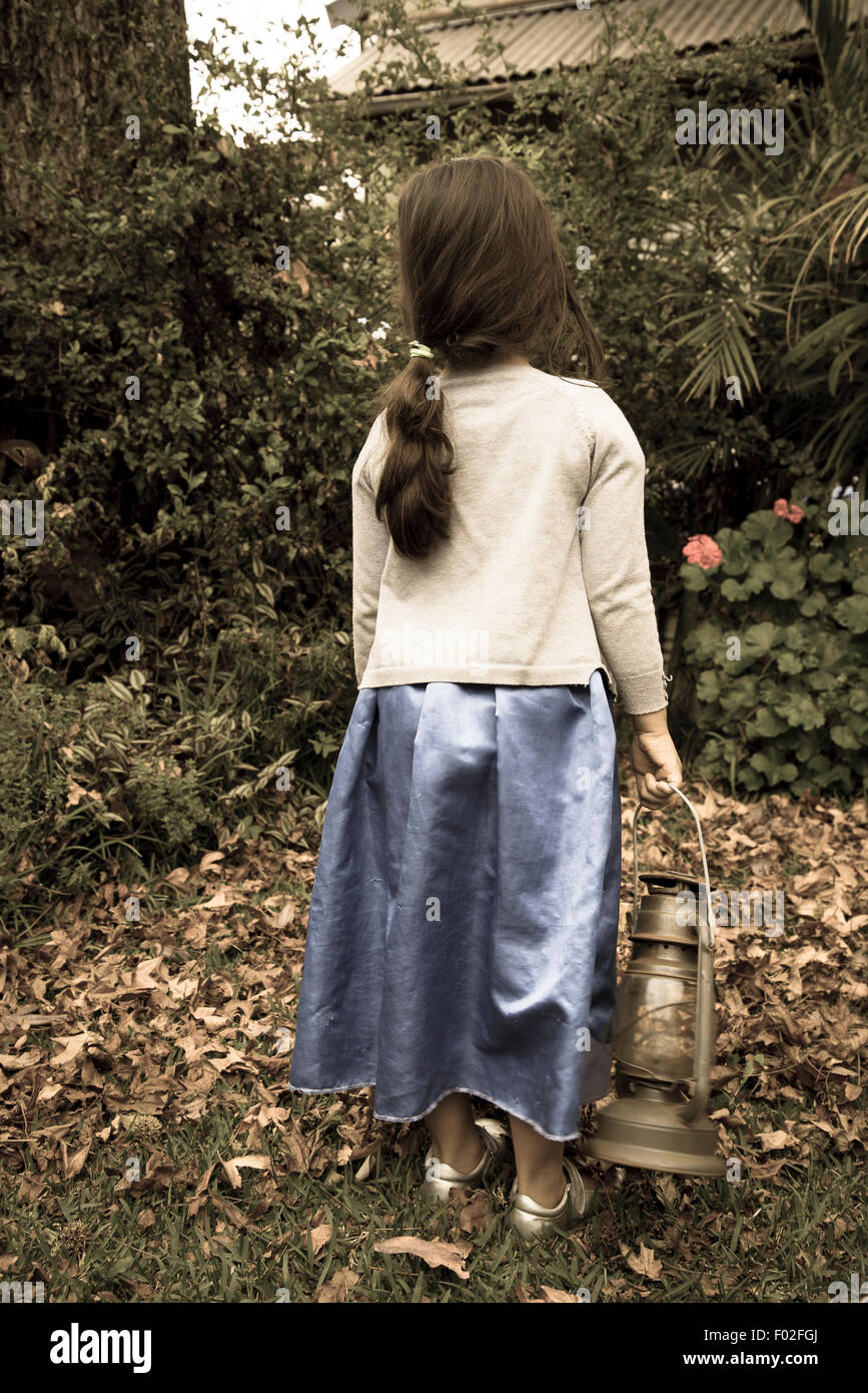 Little girl holding an old paraffin lamp Stock Photo, Royalty Free ... for Little Girl With Lamp  75sfw