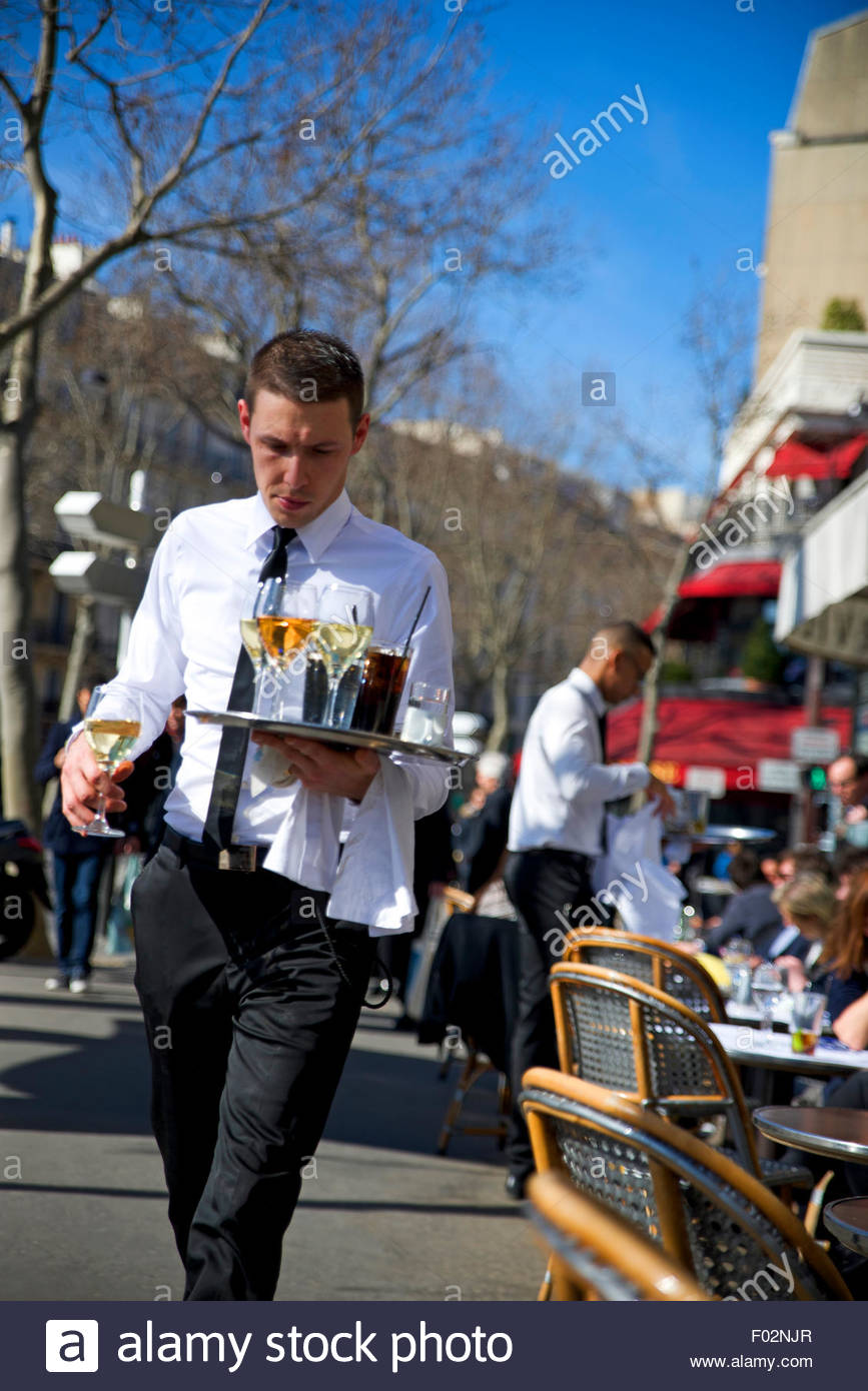waiters serving drinks to customers in le tourville cafe in paris stock photo royalty free. Black Bedroom Furniture Sets. Home Design Ideas