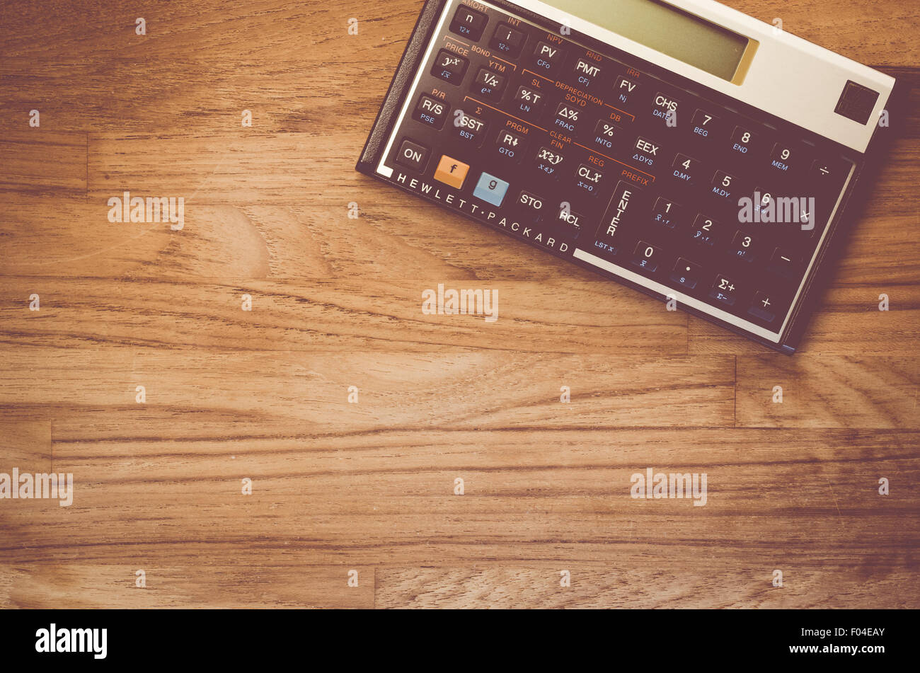 HP 12C Hewlet Packard Rpn Financial Calculator On A Natural Wood Table Top  Background