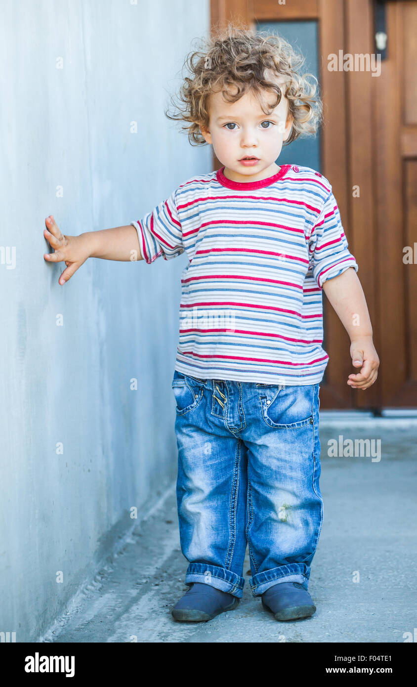 Portrait Of 1 Year Old Baby Boy Walking Outside The House