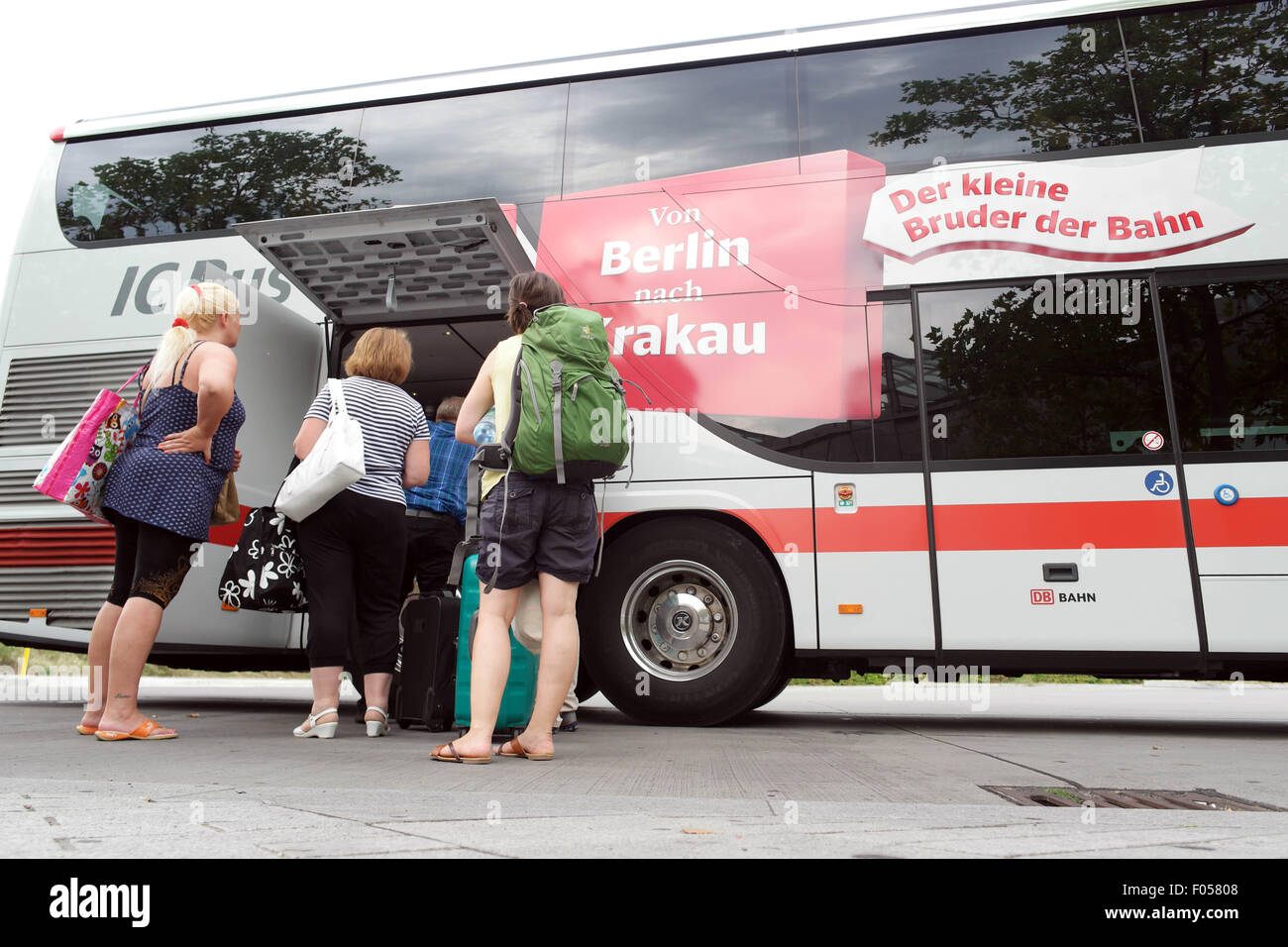 passengers enter an 39 ic bus 39 at the train station 39 suedkreuz 39 in stock photo royalty free image. Black Bedroom Furniture Sets. Home Design Ideas