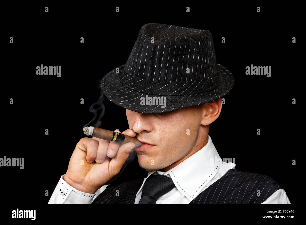 Young Gangster With Hat Smoking Cigar, Studio Shot Stock