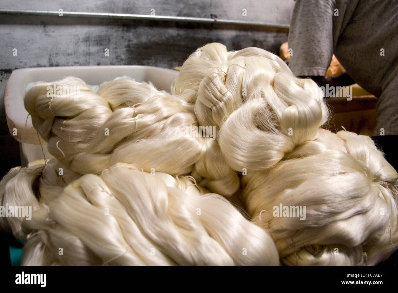 Raw silk is bundled and washed by hand at the state run for 18th century french cuisine