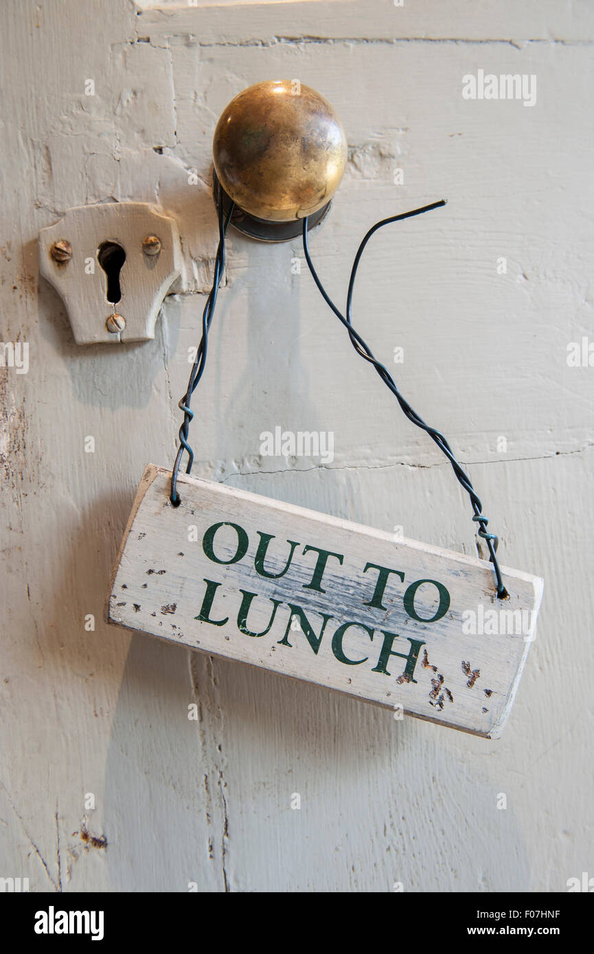 An Out to Lunch sign hangs from an old Victorian brass door handle on a shabby chic door painted white with lots of dents & An Out to Lunch sign hangs from an old Victorian brass door handle ... pezcame.com