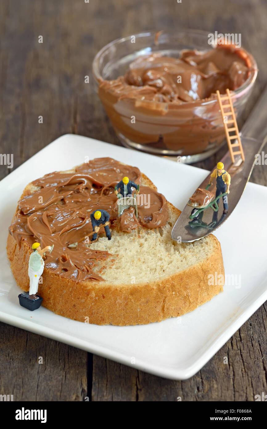 minifigure workers on bread and chocolate cream Stock Photo ...