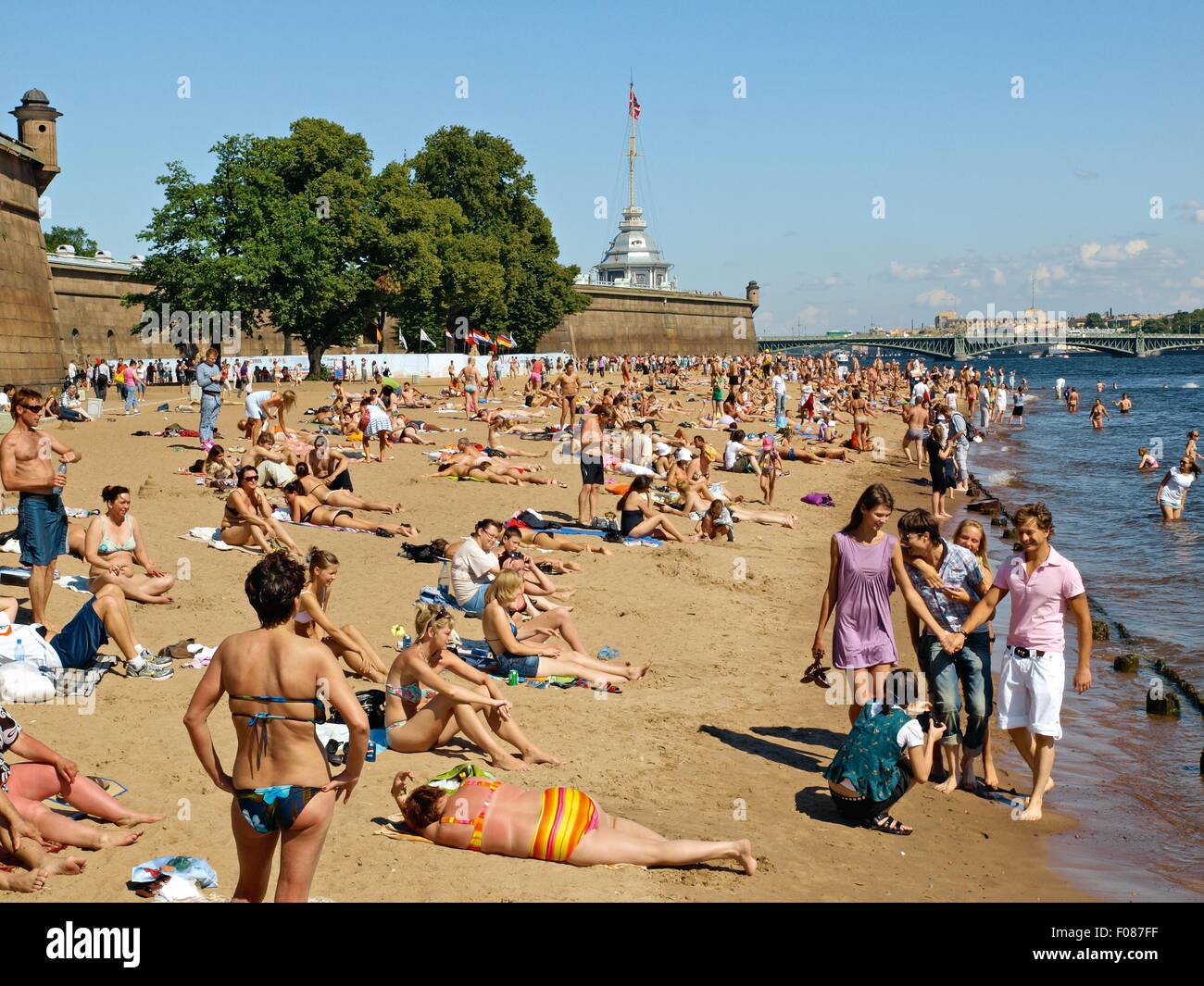 People Relaxing At Neva Beach In St Petersburg Russia
