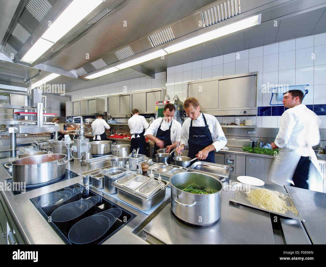 Chefs working in modern kitchen of the restaurant aqua for Authentic chinese cuisine for the contemporary kitchen
