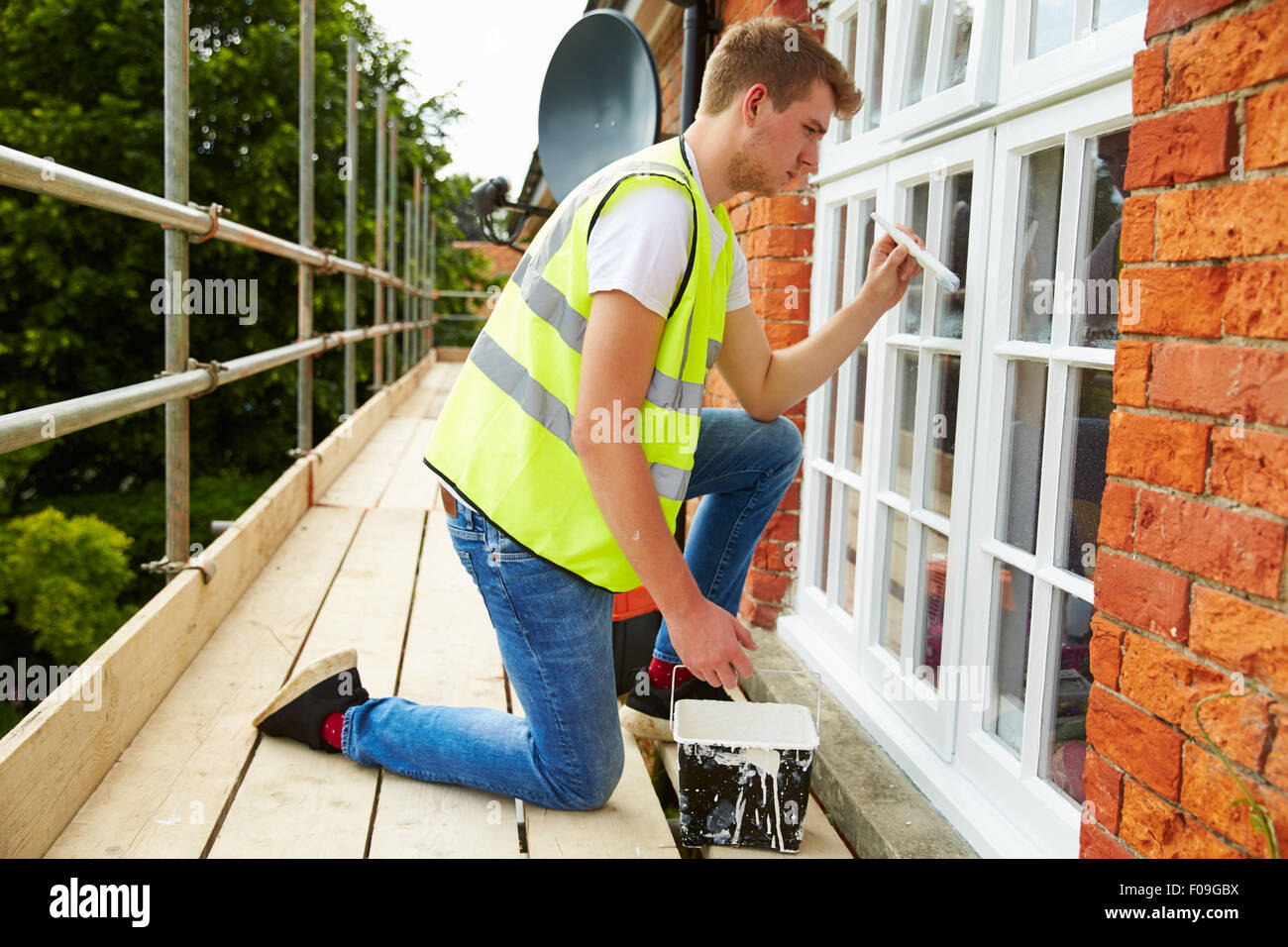 Decorator On Scaffolding Painting Exterior House WindowsDecorator On Scaffolding Painting Exterior House Windows Stock  . Painting Exterior House Windows. Home Design Ideas
