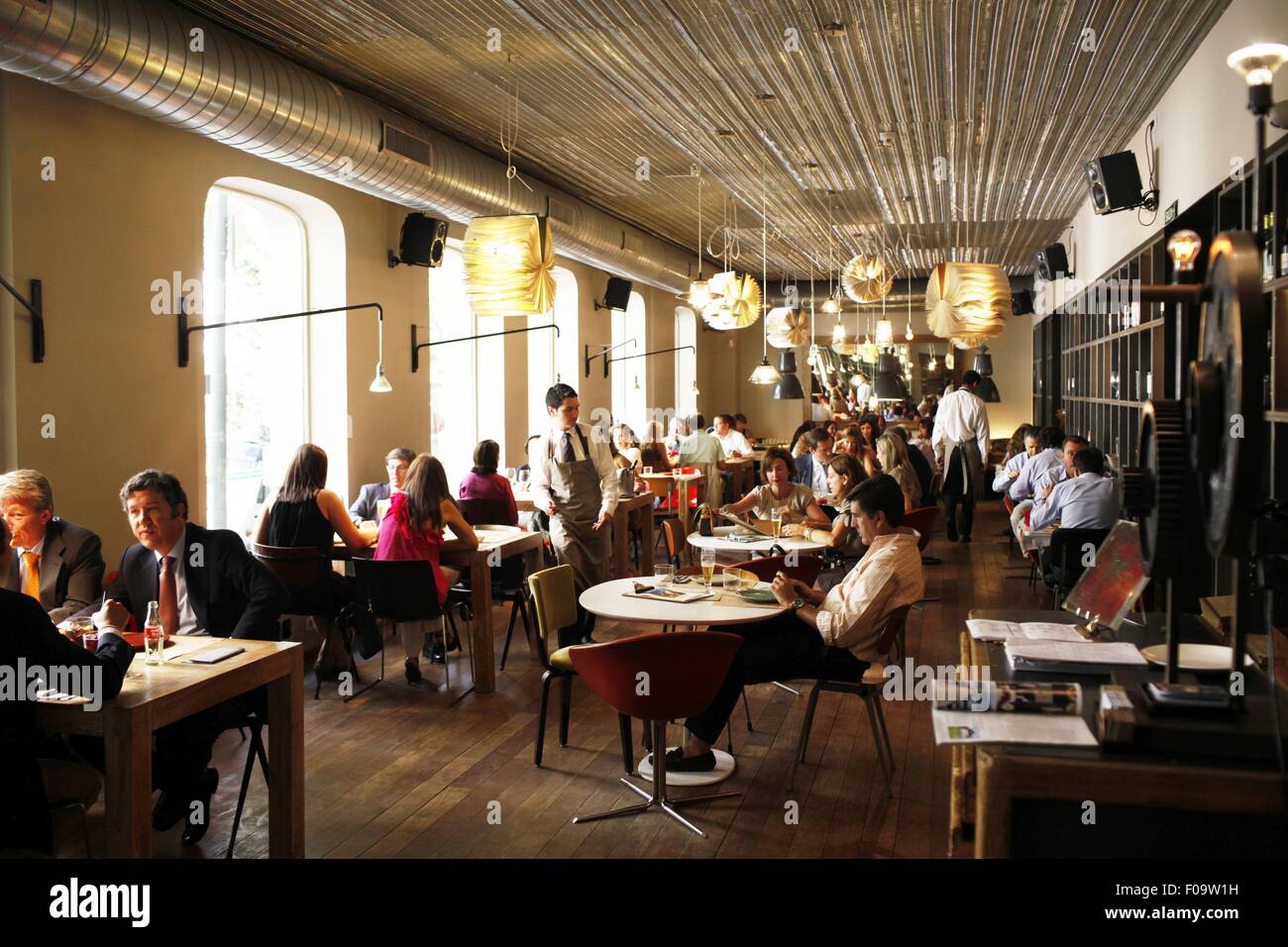 People In Dining Room Of Bar Tomate Madrid Spain